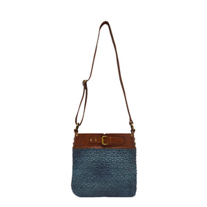 Front view of blue quilted leather bag with handle up, Joan Quilted Crossbody Bag.