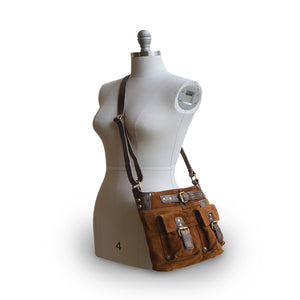 Mannequin wearing crossbody bag, tobacco, Joan Suede Crossbody Bag.