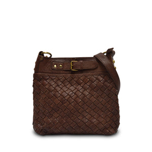 Front view of brown woven leather bag with handle down, Joan Woven Leather Crossbody.