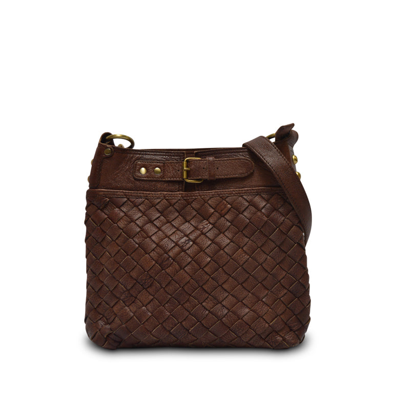 Woman sitting outside with purse, Joan Woven Leather Crossbody Bag.