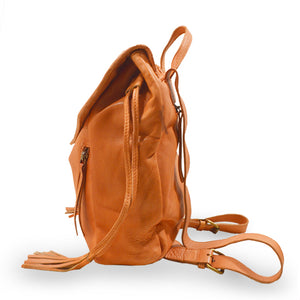 Side view of coral leather backpack with woven flap, Julie Leather Backpack.