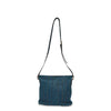 Front view of the blue leather bag with handle up, June Crossbody Bag.