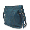 Blue leather bag at an angle, June Crossbody Bag.