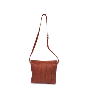Front view of rust leather crossbody bag with handle up, June Crossbody Bag.