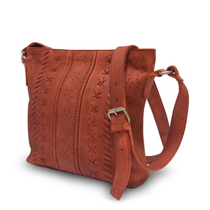 Rust leather crossbody bag at an angle, June Crossbody Bag.
