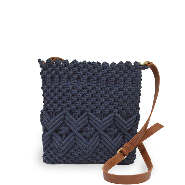 Lani crossbody bag in denim color, held up by strap