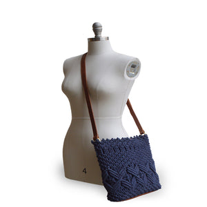 Lani crossbody bag in denim color, mannequin side view.