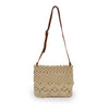 Lani crossbody bag in cream color, front view, held up by strap.