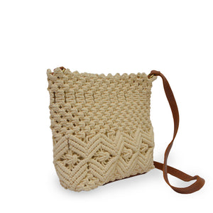 Lani crossbody bag in cream color, angled view.