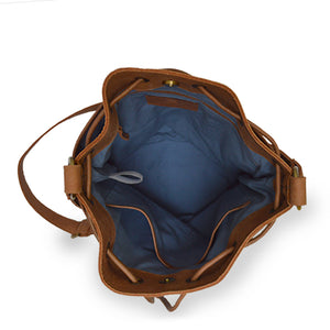 Interior view of blue checkered fabric bucket bag with leather trim, Madison Bucket Bag.