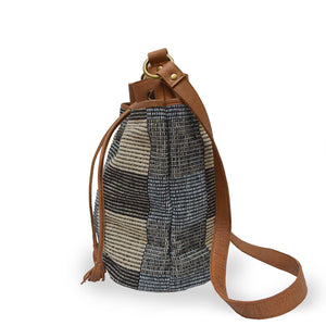 Side view of blue checkered fabric bucket bag with leather trim, Madison Bucket Bag.