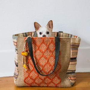 Dog poking his head out of jute tote, Margie Jute Tote.