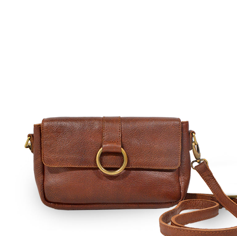 Small leather crossbody bag with a brass ring on the front, Sabrina Crossbody Bag.