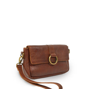Small leather crossbody bag with a brass ring on the front, clutch at an angle, Sabrina Crossbody Bag.
