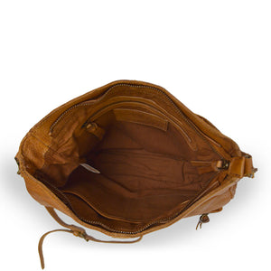 Small caramel crossbody bag with two exterior pockets, interior view, Stardust Crossbody Bag.