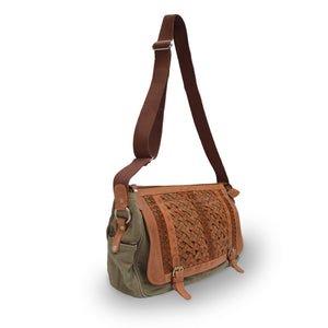 Sage green canvas messenger bag with woven leather flap, bag at an angle with the strap up, Abby Woven Messenger Bag.