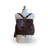 Brown leather backpack on mannequin, Beth Leather Backpack.