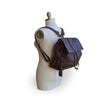 Brown leather backpack, on mannequin, side view, Beth Leather Backpack.