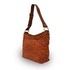 Rust leather shoulder bag with handle up, quilted floral detail, Cari Quilted Shoulder Bag.