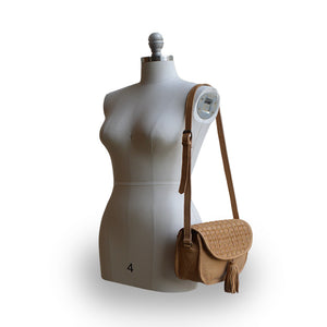 leather saddle bag on mannequin, honey, Faye Saddle Crossbody Bag.