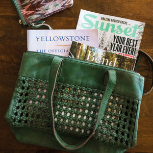 green tote on table with magazines inside with jacquard pouch nearby, Haddie Woven Tote.