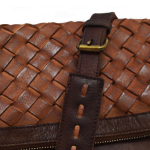 closeup shot of purse, brown leather, woven, Iris clutch.