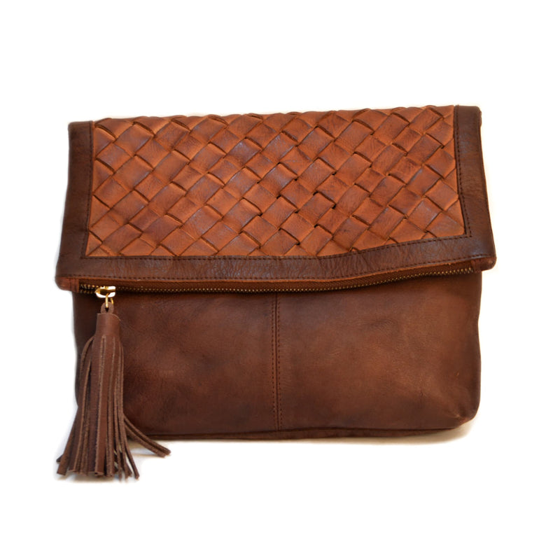 Woman wearing brown woven clutch, Iris Clutch.
