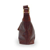 Side view of a wine colored leather shoulder bag, Nomi Shoulder Bag.