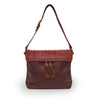 Front view of a wine colored leather shoulder bag, Nomi Shoulder Bag.