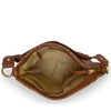 Interior view of a brown leather shoulder bag, Nomi Shoulder Bag.