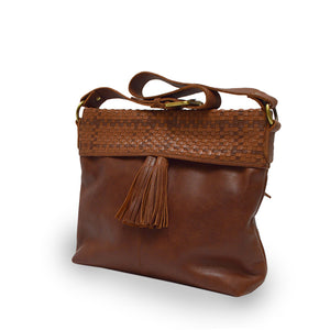 Angle view of a brown leather shoulder bag, Nomi Shoulder Bag.