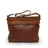 Back view of a brown leather shoulder bag, Nomi Shoulder Bag.