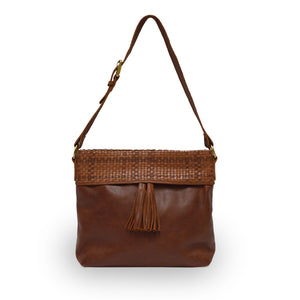 Front view of a brown leather shoulder bag, Nomi Shoulder Bag.