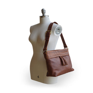 Brown leather shoulder bag on mannequin, Nomi Shoulder Bag.
