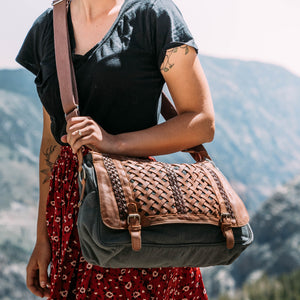 Woman in the hills wearing messenger bag, Abby Woven Messenger Bag.