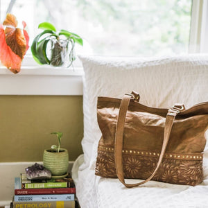 Large leather tote on bed, Goldenrod Quilted Tote.