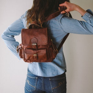 brown, leather backpack shown on model, Sadie Leather Backpack.