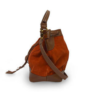 Brick suede crossbody bag, handle down, side view, Rowan Crossbody Suede Bag.