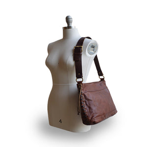 Brown leather bag on mannequin, Side Tie Shoulder Bag.