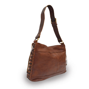 Cognac brown leather bag with handle up at an angle, Side Tie Shoulder Bag.
