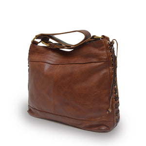 Cognac brown leather bag with handle down at an angle, Side Tie Shoulder Bag.