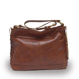 Front view of cognac brown leather bag with handle down, Side Tie Shoulder Bag.