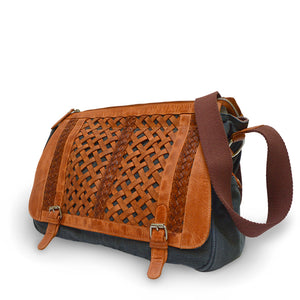 side view of canvas and leather messenger bag, Abby Woven Messenger Bag.