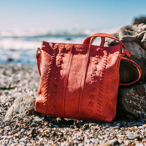 red bag on beach on a sunny day