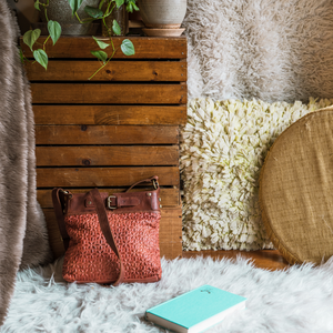 handbag in bedroom on carpet, red bag made of leather, Joan Quilted Crossbody Bag.