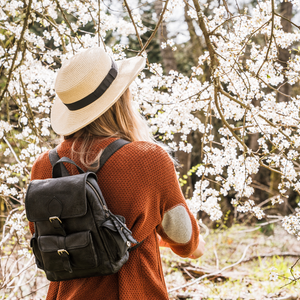woman in front of cherry blossoms in oregon wearing a small backpack, Sadie Leather Backpack