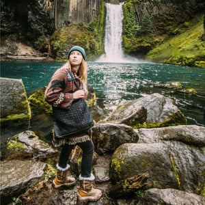 woman wearing black handbag in front of waterfall, leather purse, Hazel Shoulder Bag.