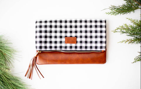 Folder over black and white check clutch