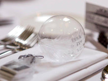 Load image into Gallery viewer, Hand stamped feather in a glass bauble
