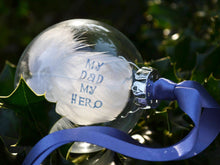 Load image into Gallery viewer, Hand stamped feather in a glass bauble, with blue text